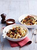 Ribbon pasta with pork and mushrooms