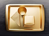 Gold-coloured disposable food set: tray, cup, napkin and cardboard box