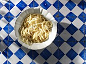 Cooked spaghetti in a dish (view from above)