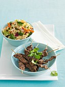 Beef skewers with satay noodles