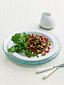 Pomegranate Salad with Chopped Walnuts, Minced Parsley and Greens