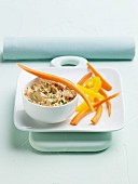 A Bowl of Tuscan White Bean Dip with Carrot and Pepper Strips