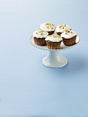 Frosted Cupcakes with Nut Topping on a Pedestal Dish