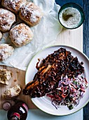 Beef rib with coleslaw and onion bread rolls