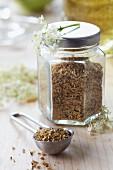 Dried elderflowers in a screw-top jar
