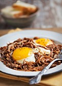 A Plate of Fried Eggs on Pulled Pork
