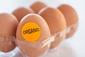 Eggs in an eggbox with an 'Organic' sticker