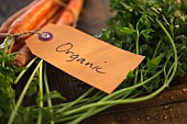 Fresh carrots labelled 'Organic'