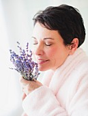 A woman holding fragrant lavender blossom
