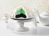 Baked Alaska (ice cream layer cake with meringue dome), sliced open