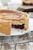 Baked blackberry & cream cake, sliced open