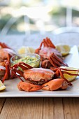 Crabs with dip and lemon