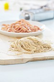 Fresh home-made pasta: tomato pasta and olive pasta