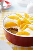 Tiramisu with oranges in a round dish