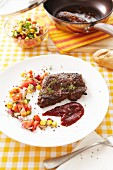 Peppered steak with a tomato and sweetcorn relish