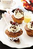 Chocolate and cherry muffins with cream