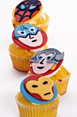 Cupcakes decorated with superheroes