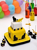 Tiered cake with a cat theme