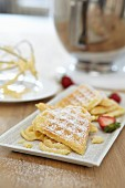 Waffle hearts with strawberries and icing sugar