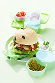 A burger with pickled gherkins and baby corn