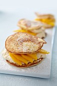 Blini sandwich with mango and cream cheese