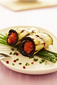 Strips of aubergine, filled with salmon and rolled