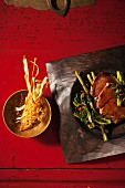 Fillet of beef with water spinach and deep-fried strips of ginger