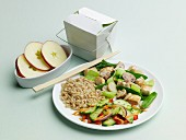 Chinese Take Out Dinner on a Plate with Take Out Carton, Apples and Chopsticks