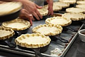 Preparing Chicken Pot Pies for Baking in a Restaurant Kitchen