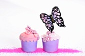 Cupcakes decorated with sugar flowers and a butterfly