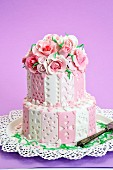 Two-tier layer cake decorated with fondant roses