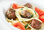 Meatballs with macaroni and tomatoes