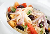 Ribbon pasta with peppers, black olives, onions and rosemary