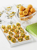Wontons with chicken, and cheese balls with olives