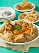 Peach pie with mint leaves