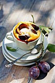 Quark soufflé with plums, in a cup