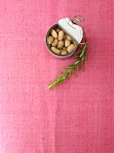 White beans in the tin and a sprig of rosemary
