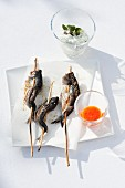 Grilled skewers of fish