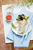 Spring rolls with chicken and salad