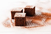 Cubes of chocolate cake with icing sugar