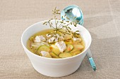 Clear broth with fish and vegetables
