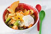 Exotic fruit salad with coconut cream