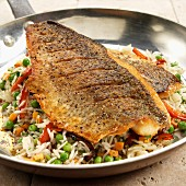 Pan Seared White Lake Bass on Bed of Rice and Vegetables