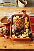 Lamb Al-Horno - Baked Leg Of Lamb, Roast Potatoes, Gravy, Roast Veges - Onion, Tomato, Garlic , Bayleaf