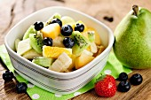Healthy fresh fruit salad, selective focus