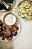 Sumac lamb with couscous and yogurt sauce