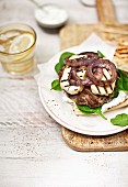Grilled Geek burger with lamb, halloumi, baby spinach and onions