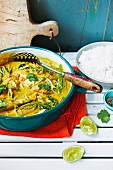 Fish curry with coconut milk and rice