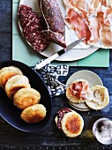 Tigelle (Italian bread rolls) with salami and Parma ham