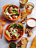 Mixed leaf salad with crispy ham and grilled bread